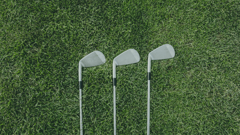 golf irons on the grass