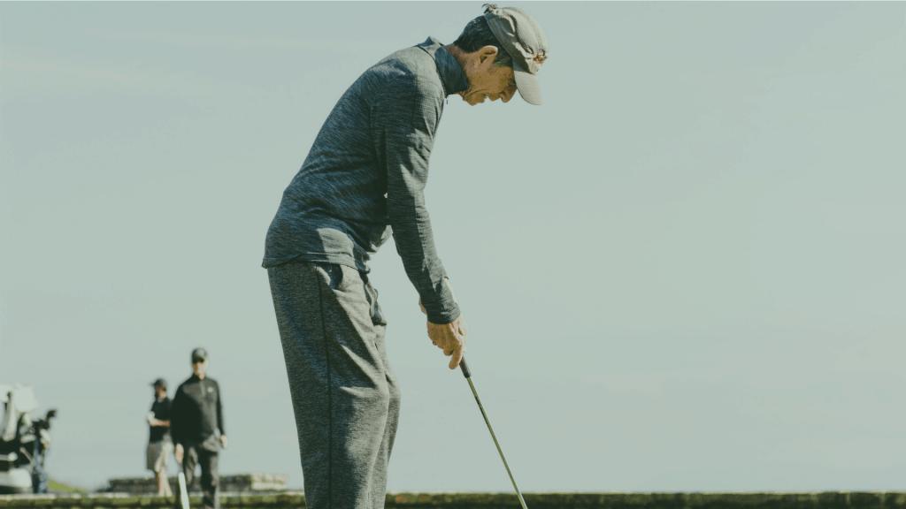 senior golfer with a club