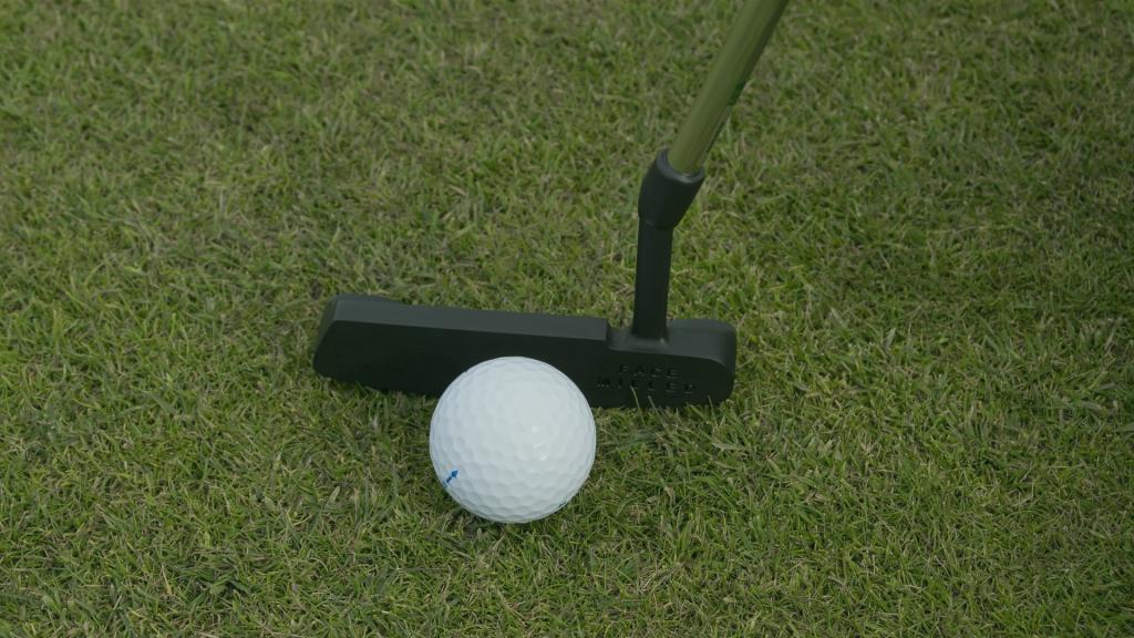 black golf putter grass