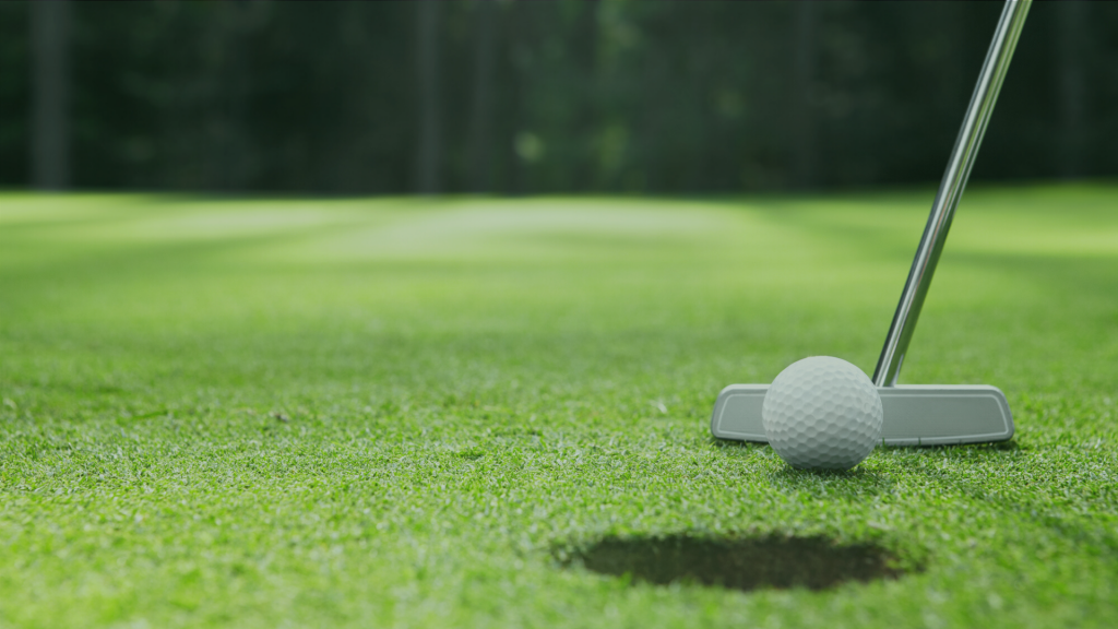 the ball at the hole and golf putter